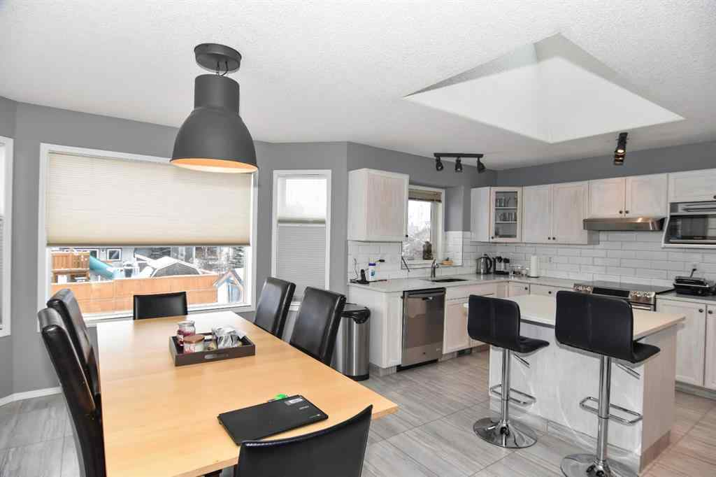 MLS® #A1047248 - 1420 Meadowbrook Drive SE in Meadowbrook Airdrie, Residential Open Houses