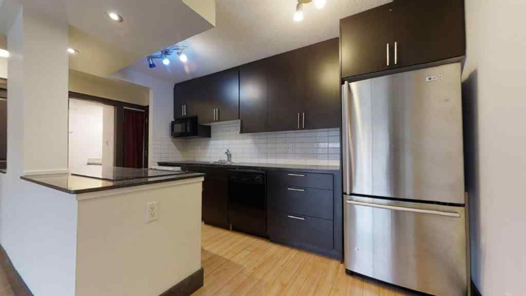 MLS® # A1052996 - Unit #405 501 57 Avenue SW in Windsor Park Calgary, Residential Open Houses