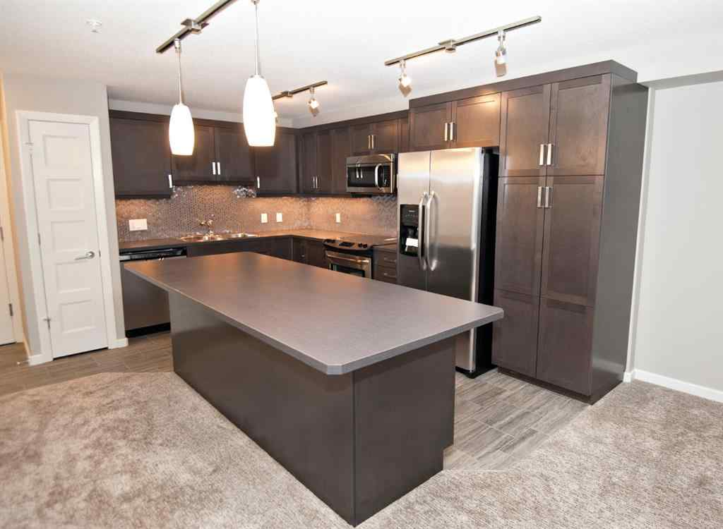 MLS® #A1054465 - Unit #1201 10 Market Boulevard SE in Kings Heights Airdrie, Residential Open Houses