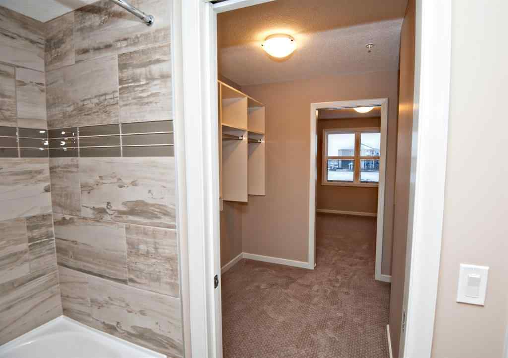 MLS® # A1054518 - Unit #2306 10 Market Boulevard SE in Kings Heights Airdrie, Residential Open Houses