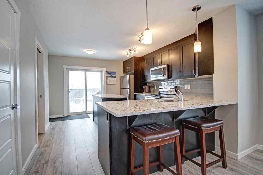 MLS® # A1055842 - Unit #1101 2400 Ravenswood View SE in Ravenswood Airdrie, Residential Open Houses