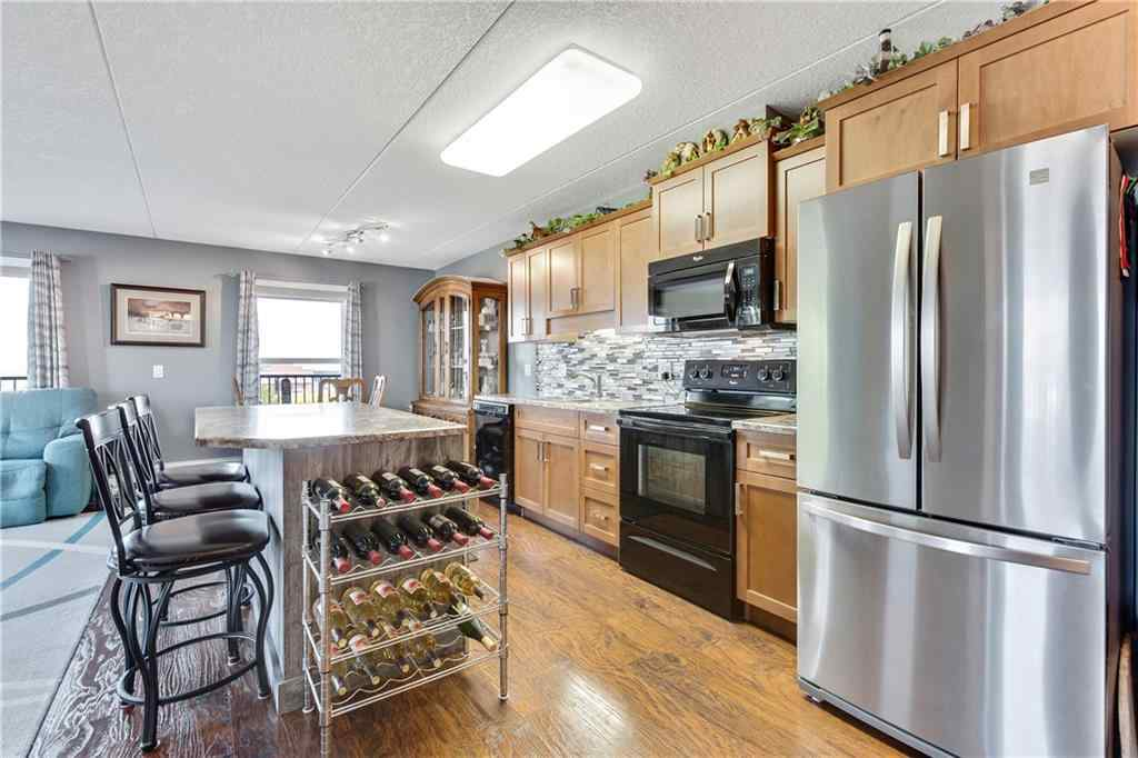 MLS® # A1056022 - Unit #207 408 1st Avenue SE in NONE Black Diamond, Residential Open Houses