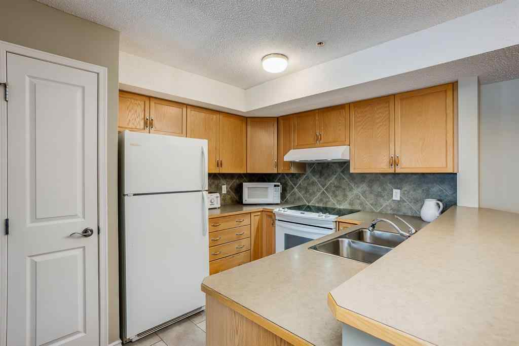 MLS® #A1056520 - Unit #206 300 Edwards Way NW in Willowbrook Airdrie, Residential Open Houses
