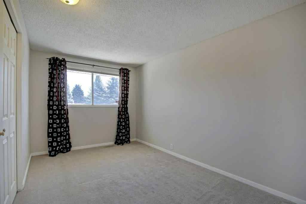 MLS® # A1056532 - 180 Woodvale Road SW in Woodlands Calgary, Residential Open Houses