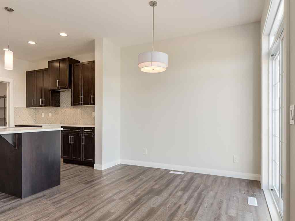 MLS® # A1056785 - 1536 RAVENSMOOR Way SE in Ravenswood Airdrie, Residential Open Houses