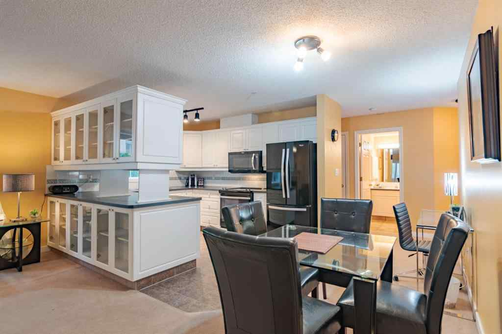 MLS® #A1057533 - Unit #103 777 3 Avenue SW in Downtown Commercial Core Calgary, Residential Open Houses
