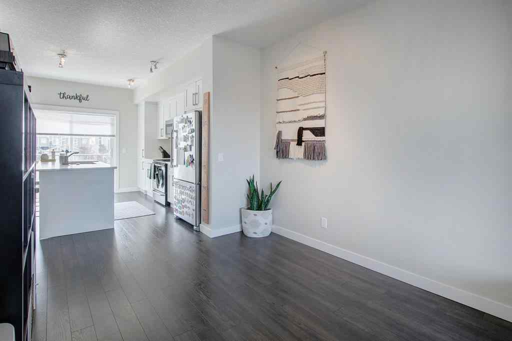 MLS® #A1061082 - Unit #105 2802 Kings Height Gate SE in Kings Heights Airdrie, Residential Open Houses