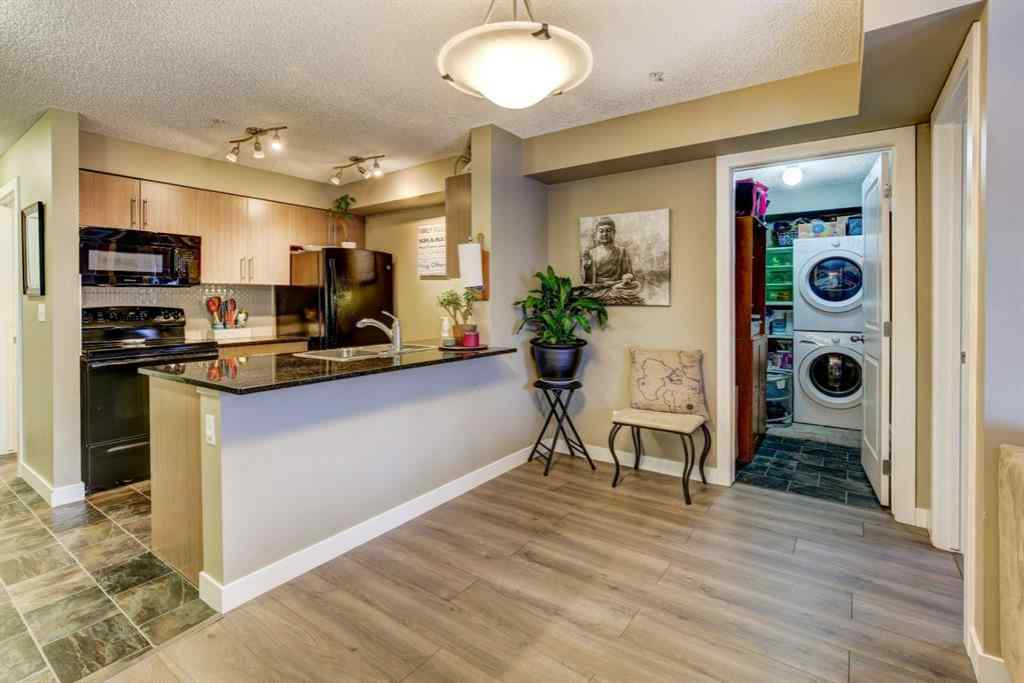 MLS® #A1062809 - Unit #9307 403 Mackenzie Way SW in Downtown Airdrie, Residential Open Houses