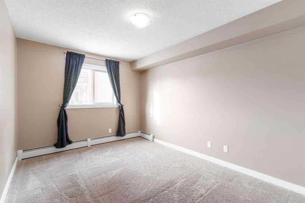 MLS® #A1064246 - Unit #8204 403 Mackenzie Way SW in Downtown Airdrie, Residential Open Houses