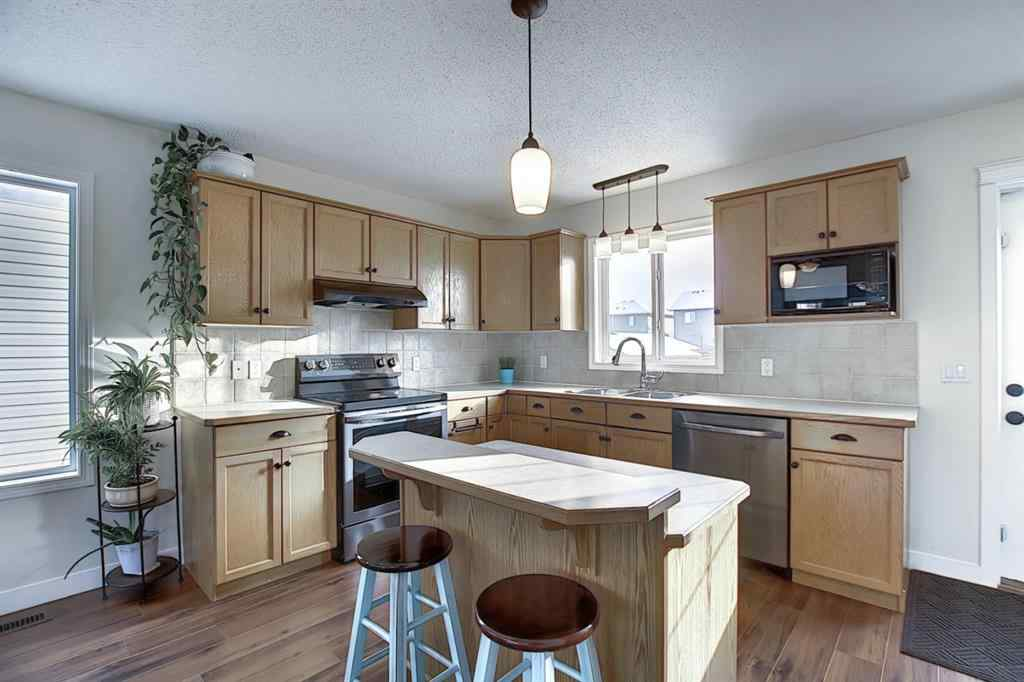 MLS® # A1064536 - 125 Luxstone Place SW in Luxstone Airdrie, Residential Open Houses