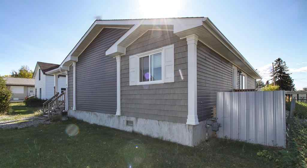 MLS® #A1065435 - 307 49 Avenue E in NONE Claresholm, Residential Open Houses