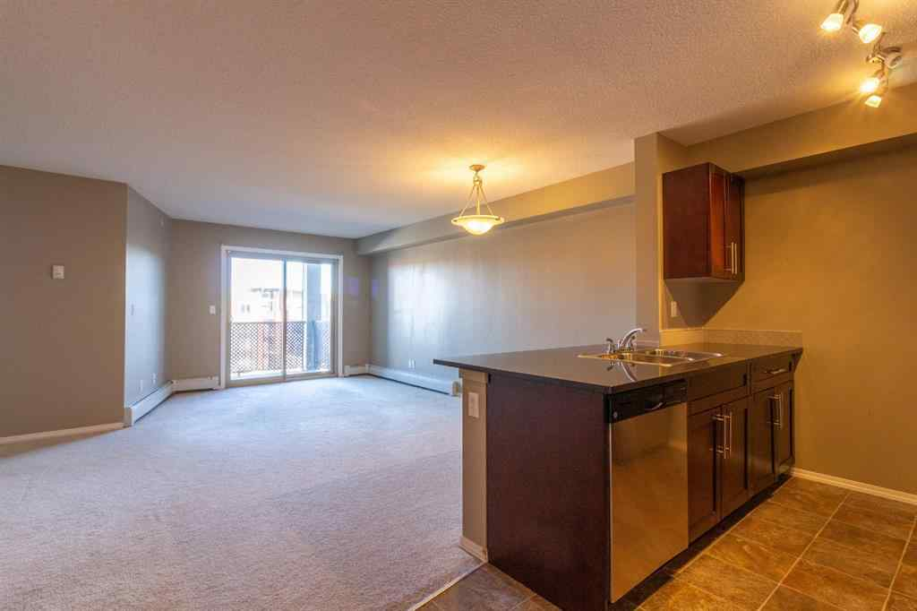 MLS® #A1065874 - Unit #9414 403 Mackenzie Way SW in Downtown Airdrie, Residential Open Houses