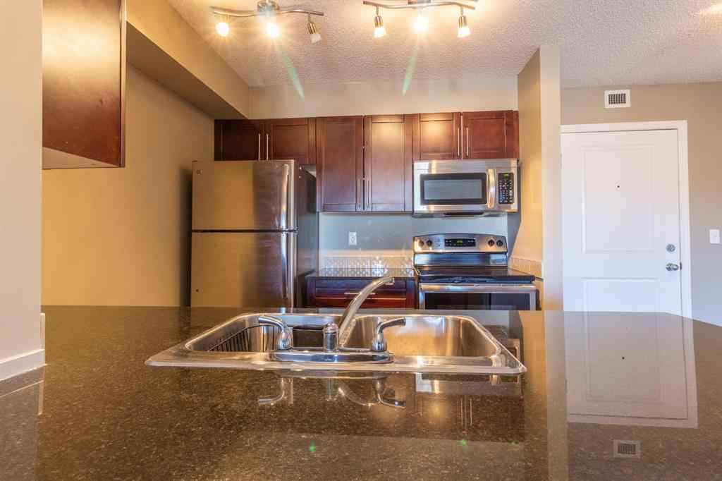 MLS® # A1065874 - Unit #9414 403 Mackenzie Way SW in Downtown Airdrie, Residential Open Houses