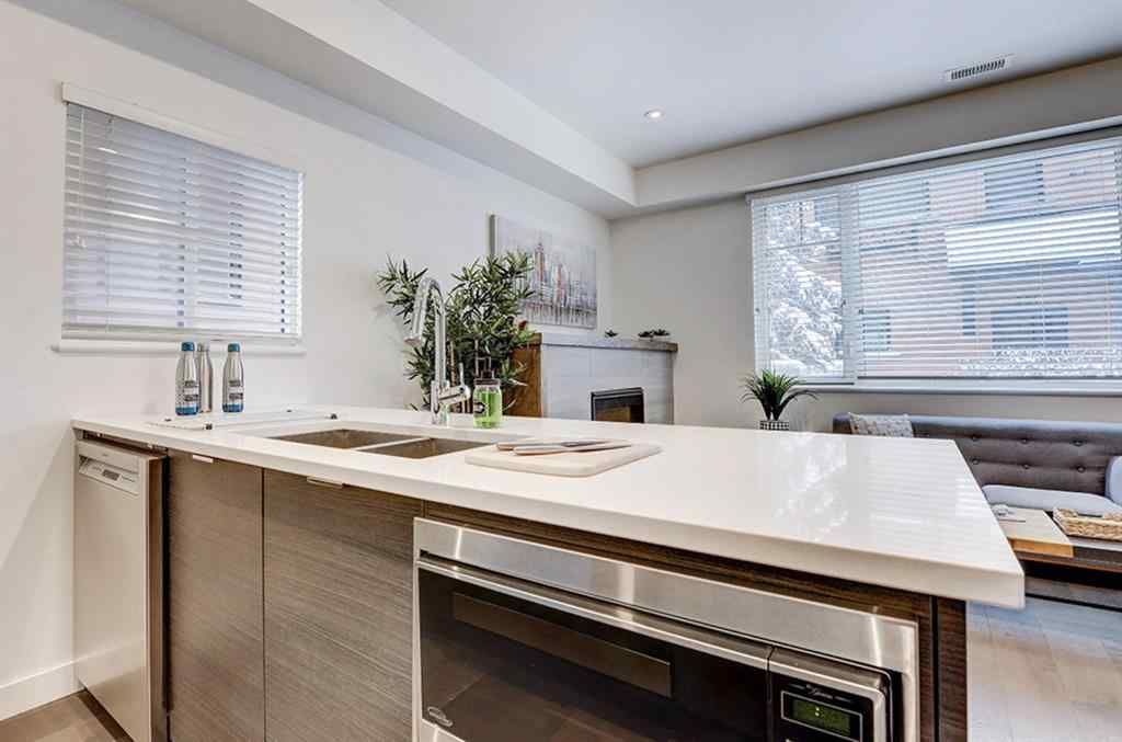 MLS® #A1066829 - Unit #101 1818 14A Street SW in Bankview Calgary, Residential Open Houses