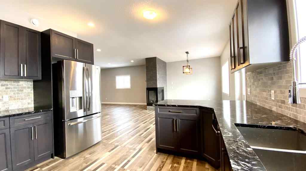 MLS® #A1068334 - 7007 49A Avenue  in Cascades Camrose, Residential Open Houses
