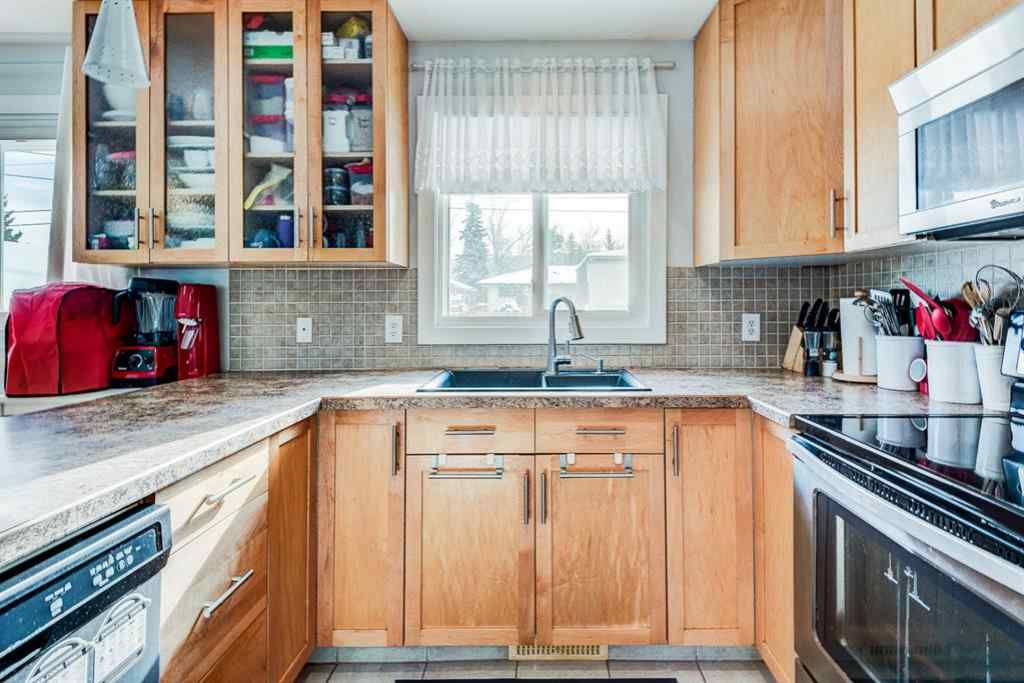 MLS® # A1069484 - 7707 34 Avenue NW in Bowness Calgary, Residential Open Houses