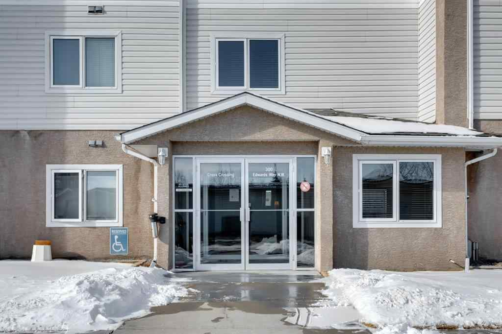 MLS® # A1071313 - Unit #406 300 Edwards Way NW in Willowbrook Airdrie, Residential Open Houses