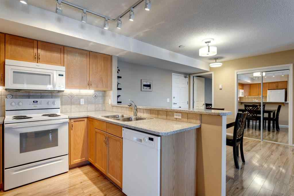MLS® #A1071313 - Unit #406 300 Edwards Way NW in Willowbrook Airdrie, Residential Open Houses