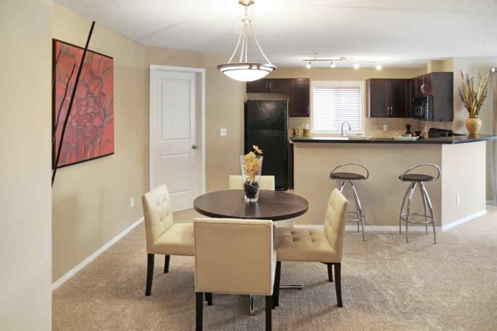 MLS® #A1071416 - Unit #7213 304 MacKenzie Way SW in Downtown Airdrie, Residential Open Houses
