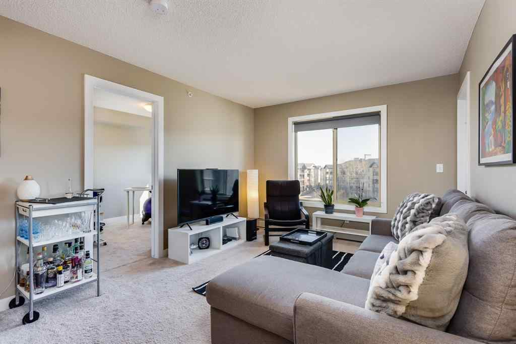 MLS® # A1086346 - Unit #8411 403 Mackenzie Way SW in Downtown Airdrie, Residential Open Houses