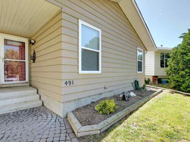 MLS® #A1010410 491 QUEENSLAND Circle SE T2J 4P5 Calgary