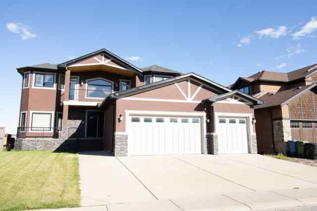42 Elmont Estates  Manor SW in Springbank Hill Calgary