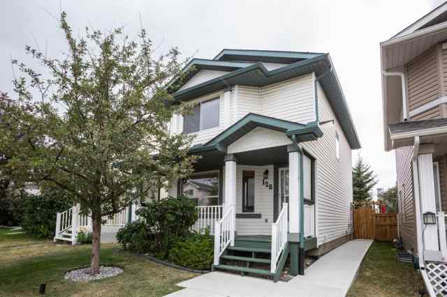 128 ARBOUR WOOD Mews NW in Arbour Lake Calgary