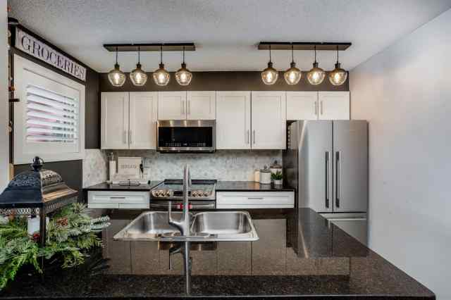 Downtown real estate 1303, 403 Mackenzie Way SW in Downtown Airdrie