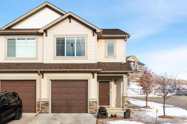 209 Sunset Point in Sunset Ridge Cochrane MLS® #A1063268