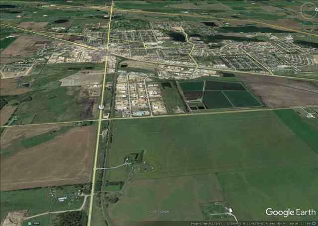 SW 28 40 26 W4 Highway 12   in Wolf Creek Industrial Par Lacombe MLS® #A1068693